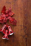 Christmas bells on wooden background Royalty Free Stock Photography