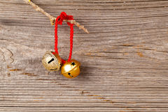 Christmas bells. On wooden background Stock Photos