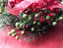 Christmas berries with ribbon Stock Photo