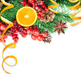Christmas berries and spruce branch with cones Stock Photo