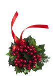 Christmas berries wreath with red ribbon. Christmas berries garland with red ribbon isolated on white Royalty Free Stock Images