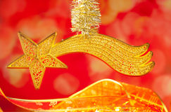 Christmas bethlehem comet gold star on red Royalty Free Stock Image