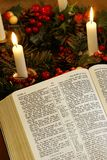 Christmas and Bible. Open Bible and advent wreath stock photos