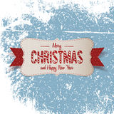 Christmas big paper Emblem with red Ribbon Stock Images