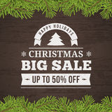 Christmas big sale background. Christmas big sale offer  poster with twig and wood plank background Royalty Free Stock Image
