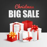 Christmas big sale banner with pile of gift boxes decorated with ribbon and bow. royalty free illustration