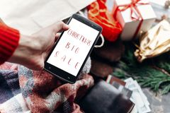 Christmas big sale. special christmas offer discount text on pho. Ne screen message on seasonal rustic background with money cards wallet and bag with stuff and Royalty Free Stock Photography