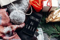 Christmas big sale. special christmas offer discount text on pho. Ne screen message on seasonal rustic background with money cards wallet and bag with stuff and Royalty Free Stock Images