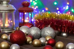 Christmas balls and lanterns on fairy lights background royalty free stock photos