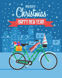 Christmas Bike Greetings Card. Christmas bicycle wishing card with traditional celebrating text. Merry Christmas and Happy New Year greetings card with winter Stock Photo