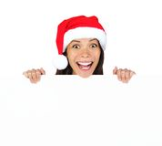 Christmas billboard woman. Christmas woman with billboard sign. Very beautiful mixed race asian / caucasian woman standing behind billboard looking happy and royalty free stock photo