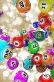 Christmas bingo balls. Gold Christmas background with falling 3D bingo balls Stock Images