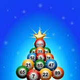 Christmas bingo lottery balls tree on blue background. Christmas Tree made of Bingo Lottery Balls Decorated with Golden Star Over Blue Glowing Background Stock Image