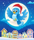 Christmas bird above town Stock Photo