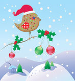 Christmas bird on a branch Stock Photo