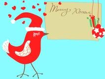 Christmas bird carrying xmas card Royalty Free Stock Photo