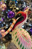 Christmas Bird - Crane. A Christmas Crane decoration in front of a Christmas tree Stock Photos