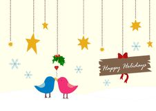 Christmas birds. Happy holiday whihes with christmas birds Royalty Free Stock Image