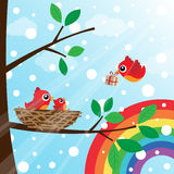 Christmas birds family with rainbow Stock Image