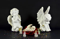 Christmas, birth on an angel from red rose, isolated on black Royalty Free Stock Photography