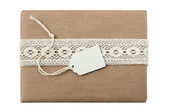 Christmas or birthday present with blank white gift tag Royalty Free Stock Photo