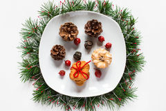 Christmas biscuits on a dish on white background Stock Photo