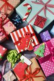 Christmas biscuits and gifts. High-angle shot of some christmas biscuits and a pile of gifts wrapped in nice papers and tied with ribbons of different colors on Royalty Free Stock Images