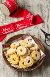 Christmas biscuits on wooden background., and a red ribbon royalty free stock image