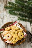 Christmas biscuits on wooden background. On the top thre are bra stock image