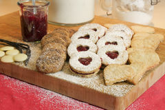 Christmas biscuits on wooden board Royalty Free Stock Photos