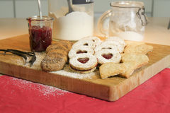 Christmas biscuits on wooden board Stock Images