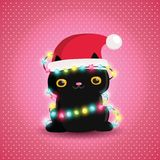 Christmas black cat with garland and santa hat Royalty Free Stock Image