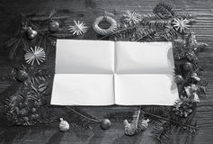 Christmas black and white background with empty paper Stock Photos