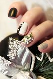 Christmas black and white manicure Royalty Free Stock Photography