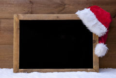 Christmas Blackboard, Red Santa Hat, Copy Space, Snow Royalty Free Stock Photo