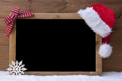 Christmas Blackboard, Santa Hat, Red Loop, Copy Space, Snow Stock Photography
