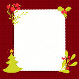 Christmas blank paper on red knitted texture Royalty Free Stock Photos