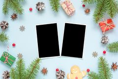 Christmas blank photo cards in frame made of fir tree branches, decorations and gift boxes Stock Photos