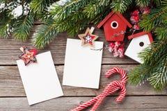 Christmas blank photo frames, birdhouse decor Stock Photos