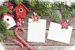 Christmas blank photo frames, birdhouse decor stock photography