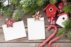 Christmas blank photo frames, birdhouse decor Royalty Free Stock Image