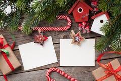 Christmas blank photo frames, decor and fir tree Royalty Free Stock Photos