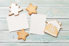 Christmas blank photo frames and gingerbread cookies. On wooden background. Top view with space for your greetings. Flat lay stock images