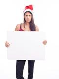 Christmas blank sign woman. Brunette Stock Image