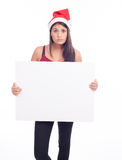 Christmas blank sign woman. Brunette Royalty Free Stock Image