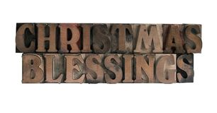 Christmas blessings. The phrase 'Christmas blessings' in old, ink-stained wood type royalty free stock photography