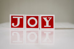 Christmas blocks spelling the word joy Royalty Free Stock Photo