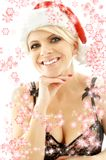 Christmas blond in lingerie black with snowflakes Stock Image