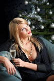 Christmas:Blond sexy woman with glass of champagne. Portrait of blond sexy woman with glass of champagne on Christmas Royalty Free Stock Photos