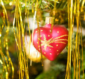 Christmas blown glass heart. Decorative red christmas heart ball Royalty Free Stock Photography